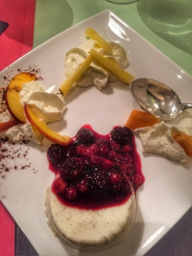 Baked cream and fruit, with whipped cream and fruit.